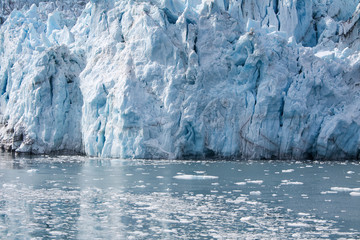 Alaska, USA: Close up of glacier with ice floes and reflections on the water