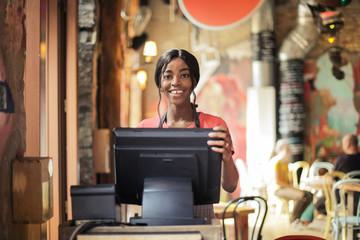 Waitress at the cash desk
