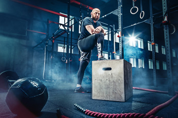 Man standing during exercises in the fitness gym. CrossFit.