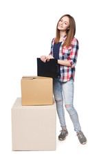 Delivery, relocation and unpacking. Full length female standing with cardboard boxes holding clipboard in hands, isolated on white background