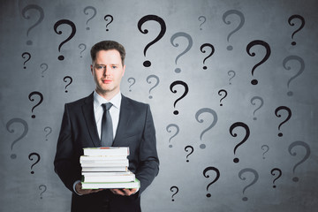 Thoughtful businessman with questions