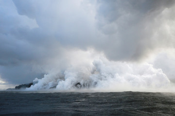 Lava flows into the Pacific Ocean southeast of Pahoa