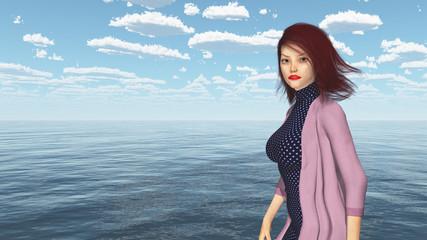 Attraktive Frau mit wehenden Haaren am Meer