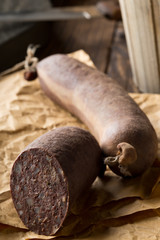 German specialty blood sausage (Blutwurst) on wooden table