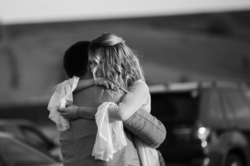 Black and white photo, the reaction of the man and the woman after she said yes. Marriage proposal, couple in love