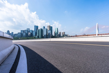 empty road with panoramic city skyline