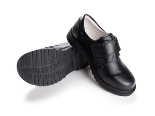 pair of brand new black leather shoe for children on white background