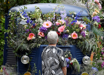 A woman views a floral display on a Citroen H-Van at the RHS Chelsea Flower Show in London, Britain
