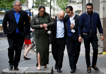 Marcio and Andreia Gomes, parents of Logan Gomes, are comforted as they arrive for a commemoration hearing at the opening of the inquiry into the Grenfell Tower disaster, in London