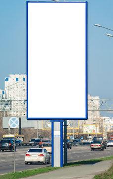 Blank vertical billboard near a highway.