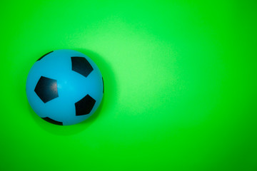 Soccer ball. Blue football on green background.