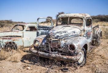 Abandoned classic cars rusting in Namib desert, Namibia