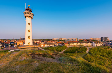Lighthouse and skyline of Egmond aan Zee, a coastal village in North Holland, The Netherlands