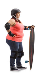 Overweight woman with protective gear and a longboard waiting in line