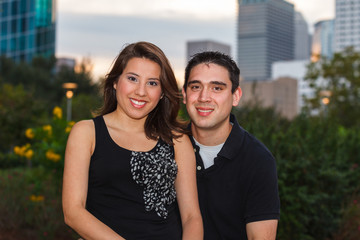 Young couple outdoor portrait in a downtown urban park