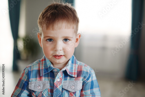 94161951 Young cute blond boy in plaid shirt smiling. The concept of a healthy  lifestyle and youth