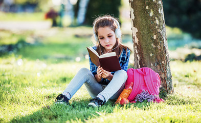 Schoolgirl reading a book. Education, lifestyle concept
