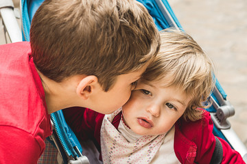 Boy giving a kiss to a little girl