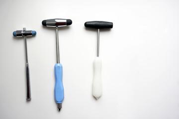 different reflex hammers on white background