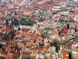 Aerial view on Prague City, Czech Republic. Tynsky temple. Panoramic view from airplane. Aerial view of Prague. The red roofs of Prague.