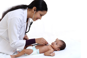 Newborn baby examination by doctor woman