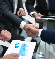 close up. investor and businessman shaking hands