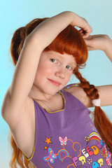 Close-up portrait of beautiful charming little redhead girl. Happy attractive child posing in a summer clothes. The pre-teen fashion model 8 years old.