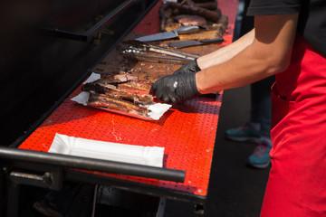 Man preparing portion of roasted meat