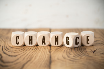 "Cubes with letters where one of them has two letters showing the words ""change"" and ""chance"" at the same time"