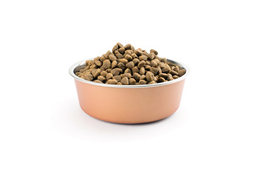 Dry dog treats in bowl isolated on white background Wall mural