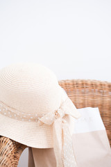 Straw hat on natural wooden chair