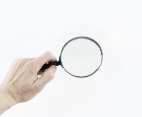 close up. magnifying glass in hand businessman.photo with copy space