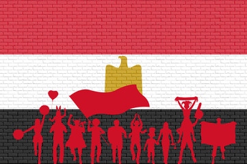 Egyptian supporter silhouette in front of brick wall with Egypt flag