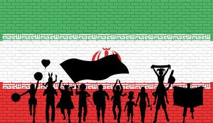 Persian supporter silhouette in front of brick wall with Iran flag