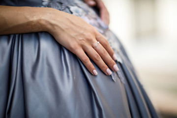 Newly wed couple's hands with wedding rings.Wedding couple holdi