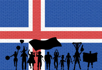 Icelander supporter silhouette in front of brick wall with Iceland flag