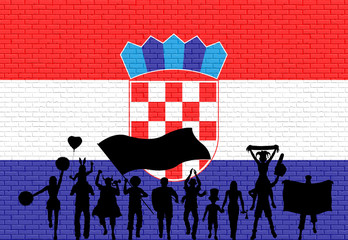 Croatian supporter silhouette in front of brick wall with Croatia flag