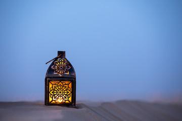 Traditional ornamental arabic lantern in desert.