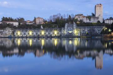 View of the Castello Visconteo and Centrale Idroelettrica Taccani on the shores of river Adda. Trezzo sull'Adda, Milan, Lombardy, Italy.