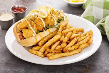 Shrimp po boy sandwich with fries