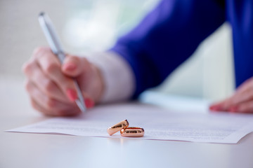 Woman signing prenuptial agreement in court