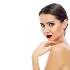 Young brunette woman wearing dark red lipstick posing. Studio lighting, retouched, isolated on white background.