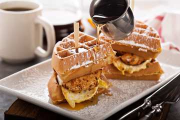 Waffle, fried egg and fish sandwich
