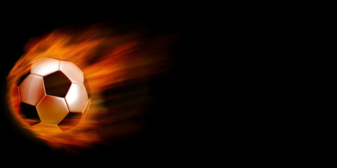 Soccer ball in fire against black background.