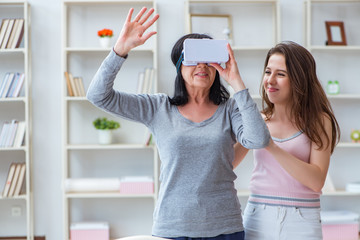 Senior woman experiencing virtual reality glasses