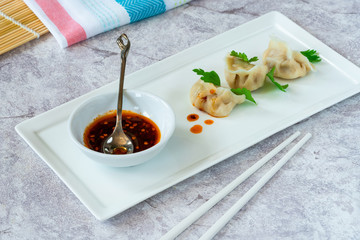 Chinese pork dumplings - dim sum - with sweet chili dipping sauce