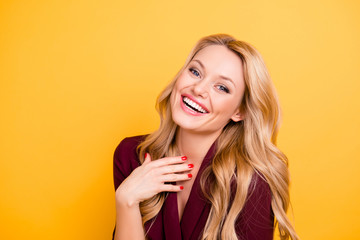 Portrait of cheerful positive sincerely woman laughing looking at camera wearing formal classic wear isolated on yellow background