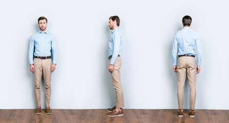 Collage of three full length portrait from all side of perfect, cool, attractive man in blue shirt, pants standing near grey wall on wooden floor