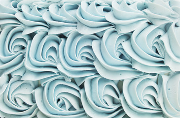Blue cake icing swirl decoration background pattern.