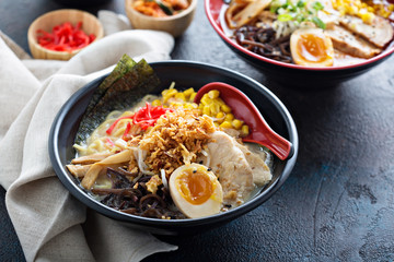 Spicy ramen bowl with noodles and chicken